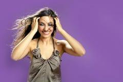 Brunette dancing at studio on purple background Stock Photo