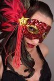 Brunette dans le masque Images stock