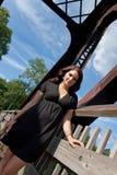 Brunette dans une robe noire Photos libres de droits