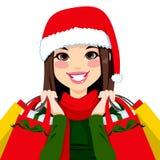 Brunette de las compras de la Navidad stock de ilustración