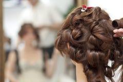 Brunette del peinado Imagen de archivo libre de regalías