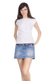 Brunette in denim skirt Stock Photo