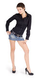 Brunette in denim skirt Stock Images