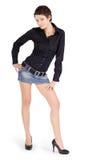 Brunette in denim skirt Stock Images