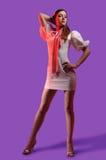 Brunette in a denim suit Stock Images
