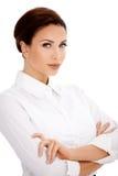 Brunette in der weißen Bluse Stockfotografie