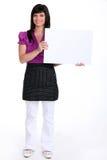 Brunette die een canvas houden Royalty-vrije Stock Afbeelding