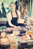 Brunette with different types of cheese in gastronomy Royalty Free Stock Photo