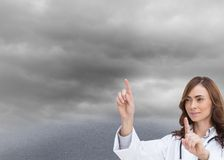 Brunette doctor selecting something with hands Royalty Free Stock Photo