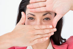 Brunette doing frame with her hands Stock Photography