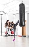 Brunette doing high kick exercise. Royalty Free Stock Image