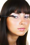 Brunette doing makeup Stock Photo