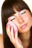 Brunette doing makeup Stock Image
