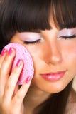 Brunette doing makeup Stock Images