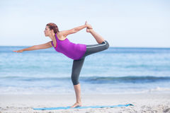 Brunette doing yoga on exercise mat Stock Photography