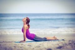 Brunette doing yoga on exercise mat Royalty Free Stock Photo