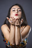 brunette in dress making hand gestures Royalty Free Stock Images