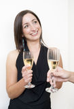 Brunette drinking champagne. With a stranger stock photo