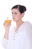Brunette drinking juice Royalty Free Stock Photography
