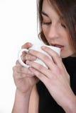 Brunette drinking coffee. Stock Image