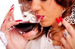 Brunette drinking red wine Royalty Free Stock Photos