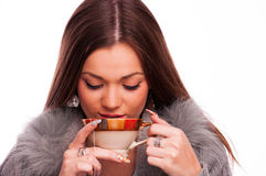 Brunette drinking tea Stock Images