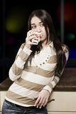 Brunette drinking Royalty Free Stock Image