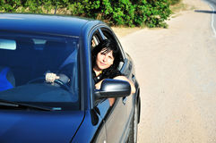Brunette driving a car Stock Photography
