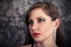 Brunette with earrings Royalty Free Stock Photography