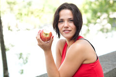 Brunette eating an apple Royalty Free Stock Photography