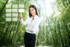 Brunette ecological businesswoman touch keypad Royalty Free Stock Photography