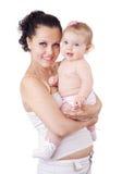 Brunette ed il suo bambino Fotografie Stock Libere da Diritti