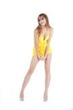 Brunette en amarillo Fotografía de archivo libre de regalías
