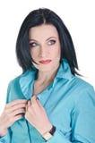 Brunette en azul Foto de archivo libre de regalías