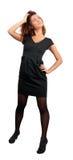 Brunette en poca alineada negra Foto de archivo libre de regalías