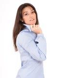 Brunette en una camisa azul Imagen de archivo libre de regalías