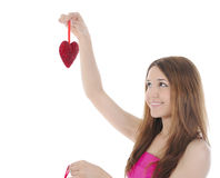 Brunette encantador con un corazón. Fotos de archivo