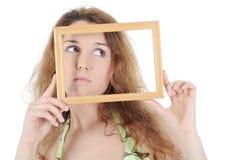 Brunette encantador con un marco Foto de archivo libre de regalías