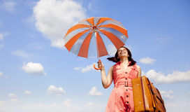 Brunette enchantress with umbrella and suitcase Royalty Free Stock Photos