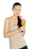 Brunette enjoying a cocktail Stock Image