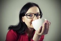 Brunette enjoying coffee Stock Photography