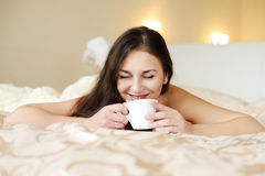 Brunette enjoying coffee Royalty Free Stock Photo