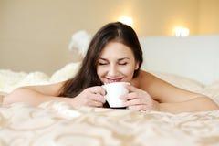 Brunette enjoying coffee Royalty Free Stock Photo