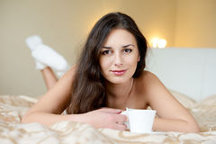 Brunette enjoying coffee Stock Photo