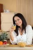 Brunette enjoying healthy breakfast Stock Images