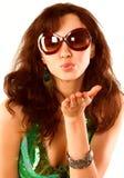 Brunette envoyant un baiser d'air Photographie stock libre de droits