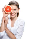 Brunette european woman with orange slice - isolated on white background Stock Photography