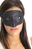 Brunette eyes in a mask Royalty Free Stock Photos