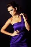 Brunette fashion girl in violet dress Royalty Free Stock Image