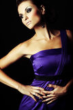 Brunette fashion girl in violet dress Stock Image